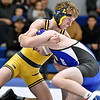 (Brad Davis/The Register-Herald) WVU Tech's Anthony Tripke takes on Ohio Valley University's Judson McCray in 125-pound weight class match Friday night inside the Van Meter Gym. OVU's McCray won the match.