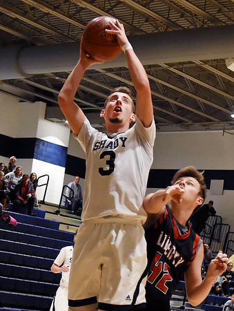Shady Sprin'g Coleton Honaker (3) puts a shot up with one-second left in the first half over Liberty's (42) during their basketball game Tuesday in Shady Spring. (Chris Jackson/The Register-Herald)