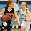 (Brad Davis/The Register-Herald) Greater Beckley Christian's Grace Mitchell looks for an open teammate as Meadow Bridge's Kaylie Persinger defends Thursday night in Meadow Bridge.