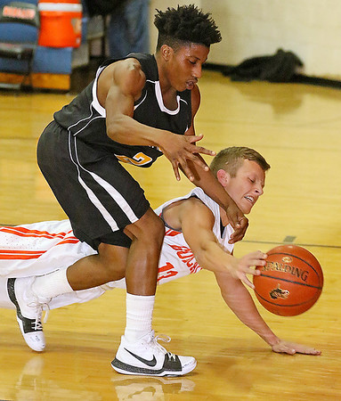 (Brad Davis/The Register-Herald) Summers County's Nathan Wykle dives to steal the ball from Mount View's De'Moni' Edwards as they try to inbound Wednesday night in Hinton.