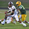 (Brad Davis/The Register-Herald) Woodrow Wilson's Avante Burnette makes a reception as Greenbrier East's Jaylon Battaile defends Friday night in Fairlea.