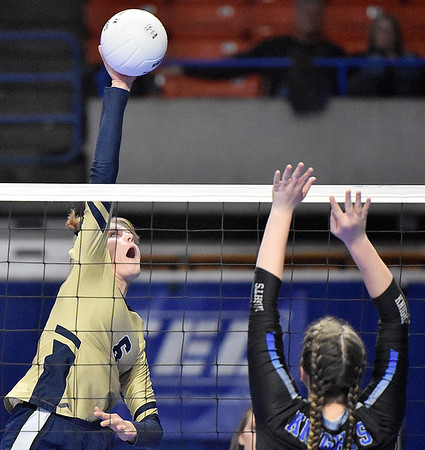(Brad Davis/The Register-Herald) Greenbrier West's Kenzie O'Dell spikes the ball as Tyler Consolidated's Alexa Johnson moves over to block during State Volleyball Tournament action Friday morning at the Charleston Civic Center.