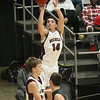 (Brad Davis/The Register-Herald) Woodrow Wilson's Bryce Radford shoots from three-point against Wyoming East during the Little General Battle for the Armory Tournament Friday night at Beckley-Raleigh County Convention Center.