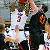 (Brad Davis/The Register-Herald) Greater Beckley Christian's Orlando Potter drives to the basket as Summers County's Andrew Richmond defends during the Crusaders' win over the Bobcats Friday night at the Beckley-Raleigh County Convention Center.