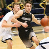 (Brad Davis/The Register-Herald) Westside's Shane Jenkins drives around Shady Spring's Tommy Williams on the way to the basket Wednesday night in Shady Spring.