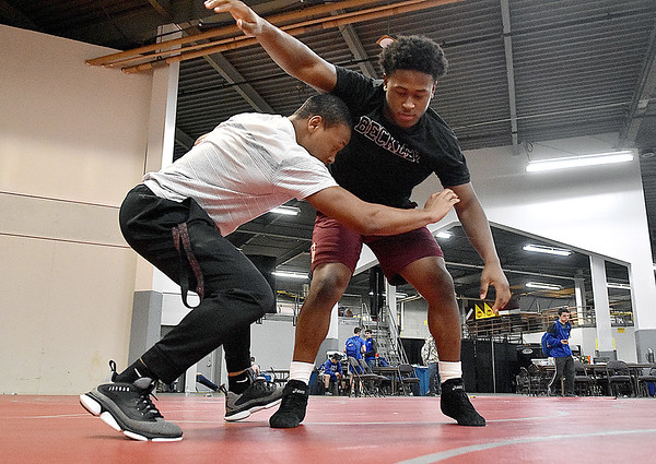 (Brad Davis/The Register-Herald) Woodrow Wilson's Tyree Swafford preps for his upcoming match against Spring Valley's Owen Porter with brother Leland Friday night at the Big Sandy Arena.