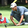 Xander Schauffele looks over his putt on the par 4, 7th hole during the first round of, A Military Tribute at The Greenbrier golf tournament.<br /> (Rick Barbero/The Register-Herald)