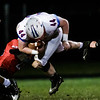 Cordell Lesher of Midland Trail is hit from the side by Oak Hill's Darrick McDowell. Chad Foreman for the Register-Herald.
