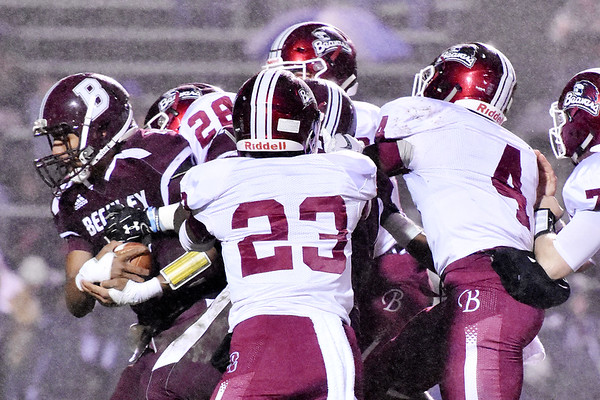 Woodrow Wilson's Peyton Shehan (3) is tackled by Bluefield's Javon Davis (28) during there football game Friday in Beckley. (Chris Jackson/The Register-Herald)