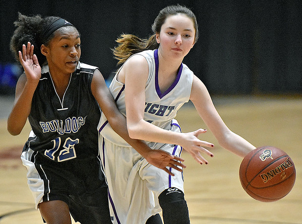 (Brad Davis/The Register-Herald) Eastern Greenbrier's Rylee Norman holds off Beckley-Stratton's Lataja Creasey as she moves the ball up the court during the Middle School Girl's championship game at the Big Atlantic Classic Wednesday afternoon at the Beckley-Raleigh County Convention Center.