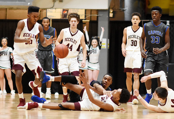 Woodrow Wilson's Mikey Penn (20) passes a loose ball he recovered to Jonah Stevens (50) during the second quarter of their basketball sectional championship against Capital Tuesday in Beckley. (Chris Jackson/The Register-Herald)