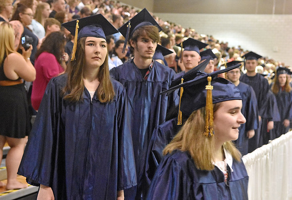 (Brad Davis/The Register-Herald) Friends and family look on as graduating Nicholas County seniors make their way into the Summersville Armory and Convention Center during the school's commencement ceremony Sunday afternoon.