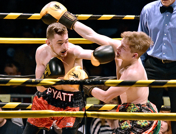 """(Brad Davis/The Register-Herald) Noah Pyatt, left, catches opponent Harley Watson with a left during their match in the """"Original"""" Toughman Contest Saturday night at the Beckley-Raleigh County Convention Center."""