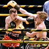 "(Brad Davis/The Register-Herald) Noah Pyatt, left, catches opponent Harley Watson with a left during their match in the ""Original"" Toughman Contest Saturday night at the Beckley-Raleigh County Convention Center."