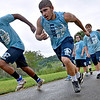 (Brad Davis/The Register-Herald) Meadow Bridge freshman Caidan Connor, far left, and senior Josh Pugh, 2nd from left, take their turns running sprints with the rest of their teammates during preseason football practice Wednesday afternoon in Meadow Bridge.
