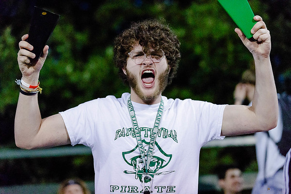 A Fayetteville fan gets excited after his team scores a touchdown. Chad Foreman for the Register-Herlad.