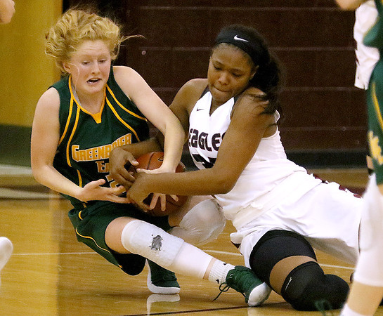 (Brad Davis/The Register-Herald) Greenbrier East's Kate Perkins and Woodrow Wilson's Victoria Staunton battle for a loose ball during the Lady Spartans' win over the Flying Eagles Thursday night in Beckley.