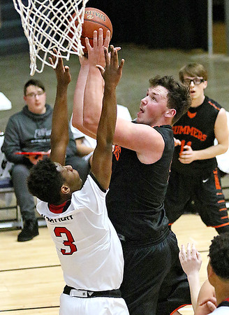 (Brad Davis/The Register-Herald) Summers County's Andrew Richmond drives to the basket as Greater Beckley Christian's Orlando Potter defends during the Crusaders' win over the Bobcats Friday night at the Beckley-Raleigh County Convention Center.