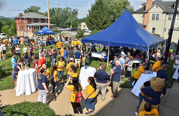 (Brad Davis/The Register-Herald) Incoming students and their families pack the lawn in front of Carter Hall during the opening moments of WVU Tech's move-in day picnic Sunday afternoon.