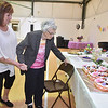 "(Brad Davis/The Register-Herald) Lifelong Bradley resident Lula Thompson, right, is escorted by granddaughter Valinda Newman to see a special cake made for her and to be serenaded with ""Happy Birthday"" by the many friends and family in attendance during her 100th birthday celebration Saturday afternoon at Bradley Free Will Baptist Church."