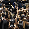 Shady Spring student Jason Meadows, a senior, crowd surfs during their football game against Wyoming East Friday in Shady Spring. (Chris Jackson/The Register-Herald)