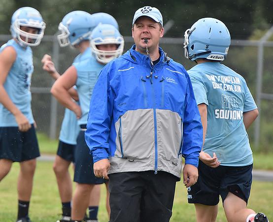 (Brad Davis/The Register-Herald) Meadow Bridge head coach Dwayne Reichard monitors his team during preseason football practice Wednesday afternoon.