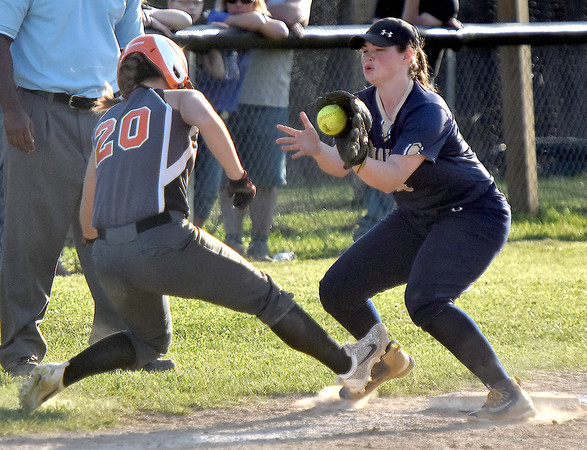 (Brad Davis/The Register-Herald) Summers County's Tiffani Cline tries to get back to third as the throw comes in to Greenbrier West infielder Brittany Bevins after Cline was caught in a rundown between 3rd base and home Wednesday evening at Western Greenbrier Middle School. Cline would be called out on the play.