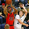 (Brad Davis/The Register-Herald) Oak Hill's Andrew Work drives to the basket as Shady Spring's Tommy Williams defends Thursday night in Shady Spring.
