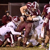 (Brad Davis/The Register-Herald) Woodrow Wilson's Nicholas Wickline plows his way through George Washington's Angel Lobato (#30) and the rest of the defense Friday night in Beckley.