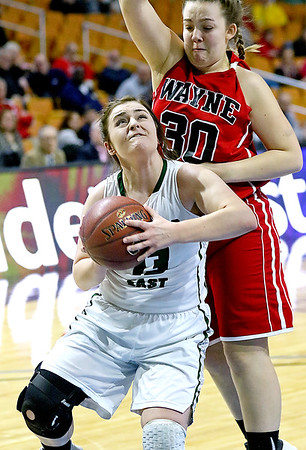 (Brad Davis/The Register-Herald) Wyoming East's Allie Lusk powers her way to the basket as Wayne's Sara Hooks defends Friday morning at the Charleston Civic Center.