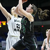 (Brad Davis/The Register-Herald) Wyoming East's Katie Daniels drives and scores as North Marion's Cara Minor defends Saturday afternoon at the Charleston Civic Center.