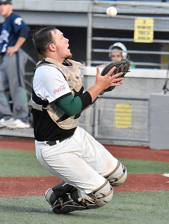 (Brad Davis/The Register-Herald) Miners catcher Dylan Shockley slides to make a tricky catch in foul territory off a pop-up by Butler hitter Andrew Chuba Wednesday night at Linda K. Epling Stadium.