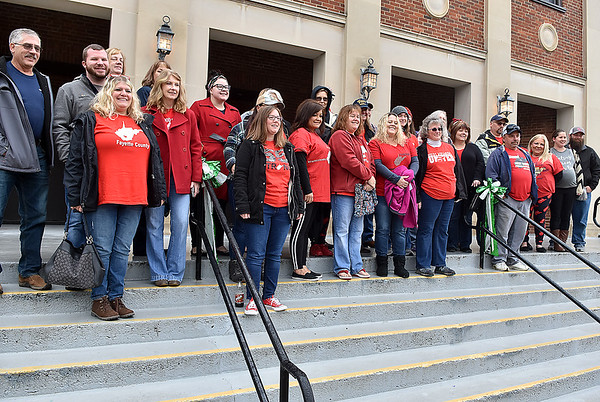 (Brad Davis/The Register-Herald) Fayette County teachers and accompanying family members pose for a quick group shot at the Soldiers & Sailors Memorial building before casting early votes Saturday morning in Fayetteville.