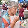 (Brad Davis/The Register-Herald) Glade Springs resident Glenda Wait enjoys destroying the elegantly-crafted Thai Roll Ice Cream sundea that was drawing so much attention at the Yummi Japan booth during Taste of Beckley.