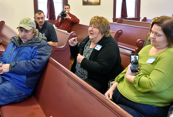 (Brad Davis/The Register-Herald) Minden resident Susie Jenkins, middle, voices concerns and asks questions of representatives from state and federal agencies on hand during the second day of public meetings on progress in the investigation of PCB's in the town Saturday morning at New Beginnings Apostolic Church.