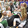 (Brad Davis/The Register-Herald) Wyoming East senior Gabby Lupardus, lower right, grabs the clipboard and helps draw up schemes as she continues contributing to the Lady Warriors' efforts on the court after going down with an injury during the second quarter of their opening round state tournament game against Lincoln Wednesday afternoon at the Charleston Civic Center.