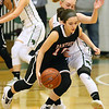 (Brad Davis/The Register-Herald) PikeView's Hope Craft is pressured by Wyoming East's Jazz Blankenship as she works along the perimeter Thursday night in New Richmond.