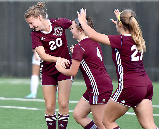 (Brad Davis/The Register-Herald) Woodrow Wilson's Logan Ragland (#20) is mobbed by teammates after scoring her first career goal against Greenbrier East Friday evening at the YMCA Paul Cline Memorial Soccer Complex.