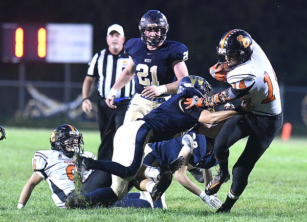 Christian Pack, of Summers Co., breaks away from Greenbrier West defenders in the first quarter for some extra yards<br /> Rick Barbero/The Register-Herald)