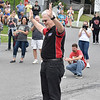 (Brad Davis/The Register-Herald) Rocket Boy Homer Hickam waves to the masses as he's introduced prior to launching the day's first rockets during the Rocket Boys Festival Saturday afternoon.