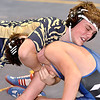 (Brad Davis/The Register-Herald) Shady Spring's Braydon Harper takes on Lewis County's Caleb Gibson as the two square off in a 145-pound weight class matchup Friday night at the Summersville Arena and Convention Center. Shady's Harper would pin Gibson to win the match.