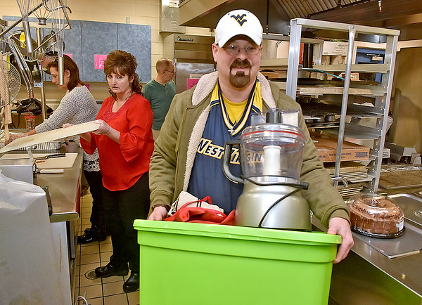 (Brad Davis/The Register-Herald) Jeff Walker arrives with the food processor as a crew of fellow church member are already preparing United Methodist Temple's annual Community Christmas Dinner Saturday night inside The Place. As they do every year, United Methodist Temple will utilize an army of volunteers young and old to feed well over 500 people in the area, and anyone is welcome. The dinner begins at 11:00 a.m. at The Place and runs until 2:00 p.m.