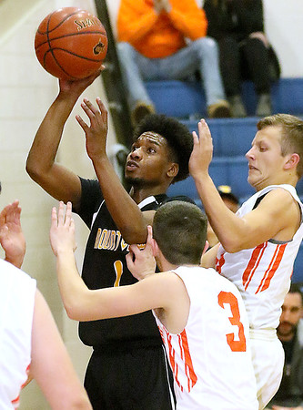 (Brad Davis/The Register-Herald) Mount View's Elijah Collier drives and scores as Summers County's Cordell Meadows (#3), and Nathan Wykle defend Friday night in Hinton.