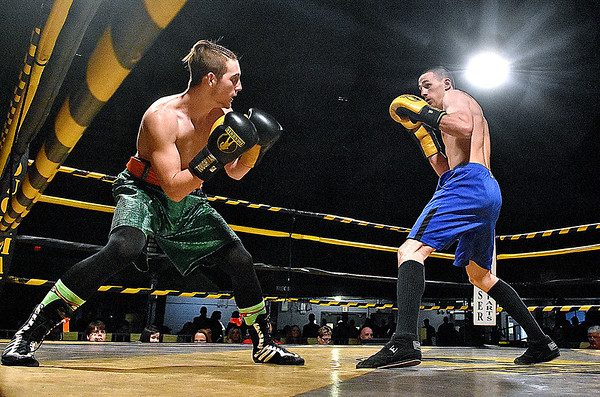 (Brad Davis/The Register-Herald) Michael Suttle, right, takes on Tre Craycraft during their match in the Original Toughman Contest Friday night at the Beckley-Raleigh County Convention Center.