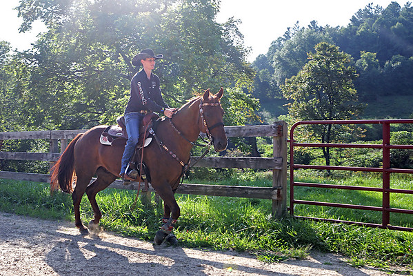 Antonette Gwinn, a Beckley-Stratton Middle School math teacher with her horse Cruiser at their farm in Mt. Hope. Gwinn and Cruiser will be competing at the National Barrel Horse Association World Championship at the end of October.  (Jenny Harnish/The Register-Herald)