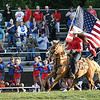 Madison Deck, senior at Independence High School, rides her horse around the field during the national anthem in a game against Midland Trail Friday night at Independence High School.<br /> Rick Barbero/The Register-Herald)