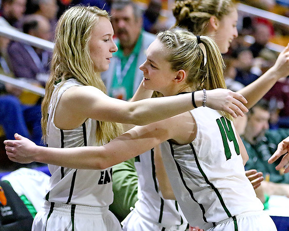 (Brad Davis/The Register-Herald) Wyoming East senior Gabby Lupardus hugs teammate Jazz Blankenship as the Lady Warriors celebrate their State Tournament win over Wayne Friday morning at the Charleston Civic Center.