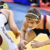 (Brad Davis/The Register-Herald) Independence's Sean Dawson takes on Williamstown's Colton Slagel in a 120-pound weight class matchup during state wrestling tournament action Thursday night at Huntington's Big Sandy Arena.