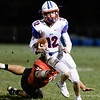Austin Isaacs of Midland Trail avoids a diving tackle by Oak Hill's Logan Lawhorn. Chad Foreman for the Register-Herald.