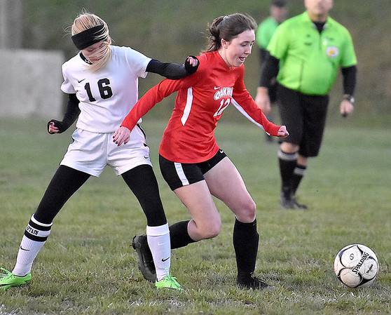 (Brad Davis/The Register-Herald) Oak Hill's Courtney Smith works her way past PikeView's Leah Flanigan Wednesday evening in Oak Hill.